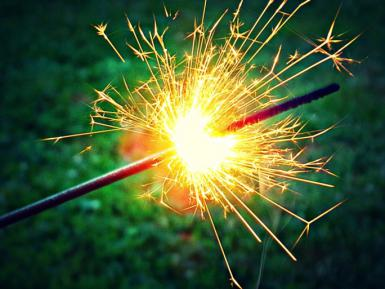 Close-up of sparklers against blurred background