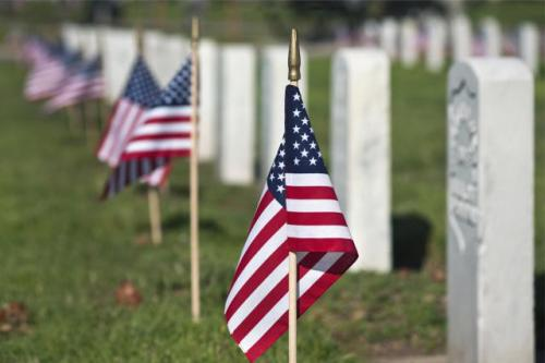 US flags at graves at Veterans cemetery